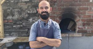 Turkish chef Ahmet Dede in the barbecue area of his new restaurant, Dede, in Baltimore. Photograph: Corinna Hardgrave