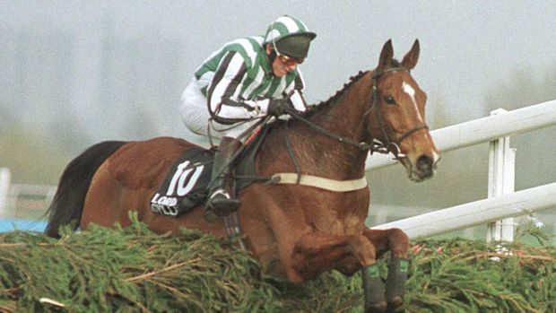 Jockey Tony Dobbin on Lord Gyllene jumps the last fence on his way to victory in the 1997 Grand National, which was finally run on the Monday. Photograph: Inpho/Allsport