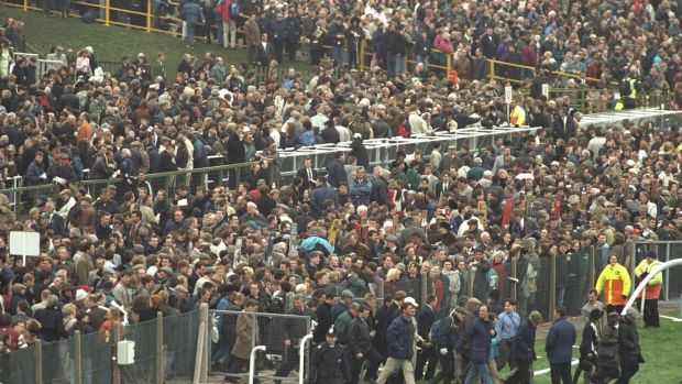 Crowds file on to the Aintree course after the order came of evacuate the stands following a bomb scare ahead of the 1997 Grand National. Photograph: Mike Cooper/Allsport