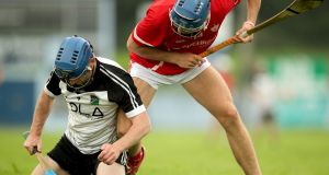 Keith Kennedy of JK Brackens and Conor Booth of Roscrea during their Tipperary Senior Hurling Championship game at Éire Óg Nenagh GAA club on Saturday. Photograph: James Crombie/Inpho