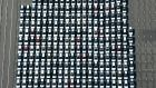 Room for one more? Vehicles are parked before being exported in Kawasaki, near Tokyo. Photograph: Kyodo News via AP