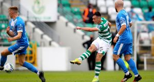 Aaron McEneff scores Shamrock Rovers' third goal during the SSE Airtricity League Premier Division game against Finn Harps at  Tallaght Stadium. Photograph: Ryan Byrne/Inpho