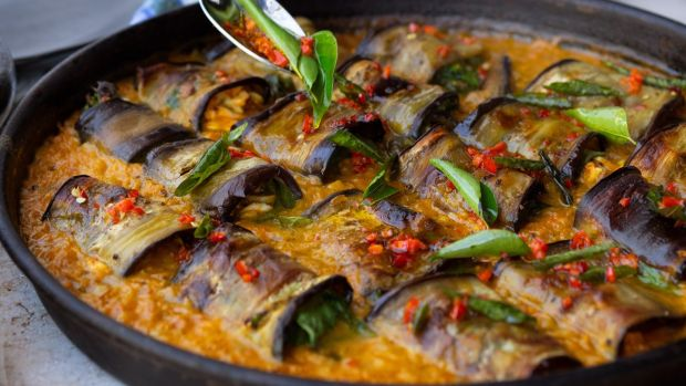 Stuffed aubergine in curry and coconut dal. Photograph: Jonathan Lovekin