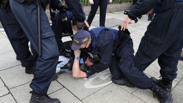 A man being apprehended during the protest which was held at the Custom House, Dublin. Photograph Nick Bradshaw / The Irish Times