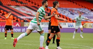 Celtic's Albian Ajeti celebrates scoring at Tannadice Park. Photograph: PA