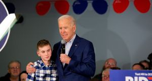 Joe Biden talks with Brayden Harrington (13)  about stuttering, something they share, during a  campaign stop in  February. Photograph: Elizabeth Frantz/The New York Times
