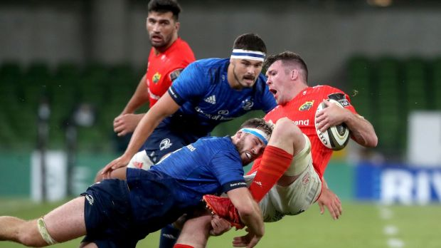 Leinster's Caelan Doris tackles Peter O'Mahony of Munster during the game at the Aviva Stadium. Photograph: Bryan Keane/Inpho