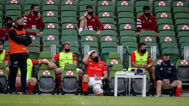 Munster's RG Snyman watches from the bench after suffering a knee injury early in the Guinness Pro 14 game against Leinster at the Aviva Stadium. Photograph: Dan Sheridan/Inpho