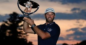 Dustin Johnson holds the trophy after winning the Northern Trust Open at TPC Boston. Photograph: AP