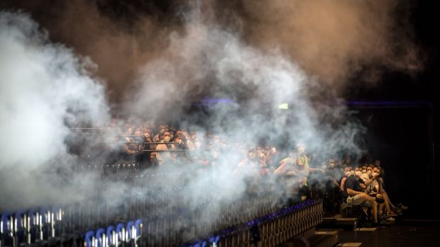 Smoke machines were used to study the spread of aerosols during the concert at the Quarterback Immobilien Arena in Leipzig, Germany. Photograph: Gordon Welters/The New York Times