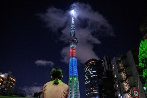 TOKYO 2021: A bypasser observes the specially illuminated Tokyo Skytree in Tokyo as the city marks one year to go until the postponed Tokyo 2020 Paralympic Games is scheduled to proceed. Photograph: Philip Fong/AFP/Getty