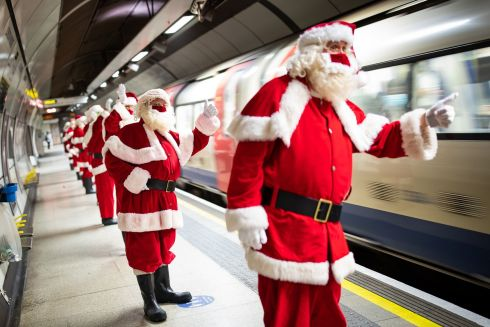 PLANNING AHEAD: Members of the santa school catch a tube train to Southwark Cathedral, London.  The Ministry of Fun's summer school aims to plan for Covid-safe Christmas grottos by teaching Father Christmases how to appear safely in person while maintaining the Christmas magic. Photograph: Aaron Chown/PA Wire