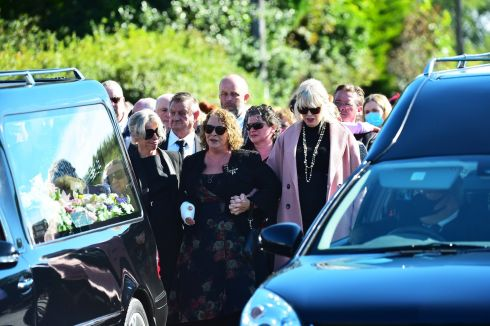FAMILY TRAGEDY: Geraldine Mullan during the funeral of her husband John (49), Thomas (14) and Amelia (6) at St Pius X Parish Church in Moville, Co Donegal, on Monday. The three died after their car entered the water in Lough Foyle. Ms Mullan managed to escape the vehicle and seek help, but her family members lost their lives. Photograph: Colm Lenaghan/Pacemaker