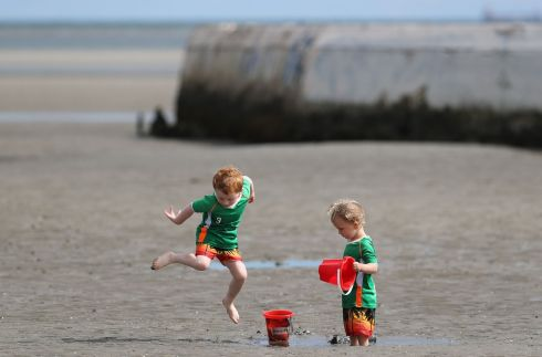WATER WORKS: Thomas Barrett (4) and his brother Tadhg (2), from Churchtown, Dublin, enjoying time at the seaside in Dublin. Photograph: Nick Bradshaw