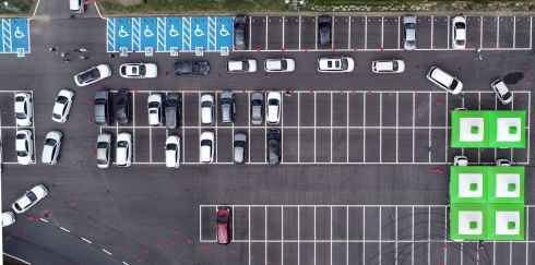 HIGH TURNOVER: Cars queue at a Covid-19 drive-thru test facility at a parking lot in Hwasun, South Korea. Photograph: Yonhap