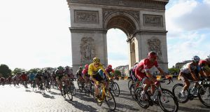 Chris Froome  and the rest of the peloton cycle past the Arc de Triomphe during the final stage of the 2016 Tour de France. Photograph:  Michael Steele/Getty Images