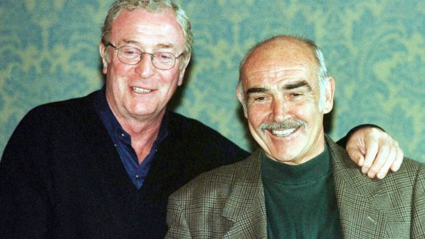 EDN03:BRITAIN-FESTIVAL:EDINBURGH,SCOTLAND,24AUG97 - British actors Sean Connery (R) and Michael Caine (L) stand on the stairs in Edinburgh's Caledonian Hotel, after holding a press conference to discuss the Film Festival's closing film,
