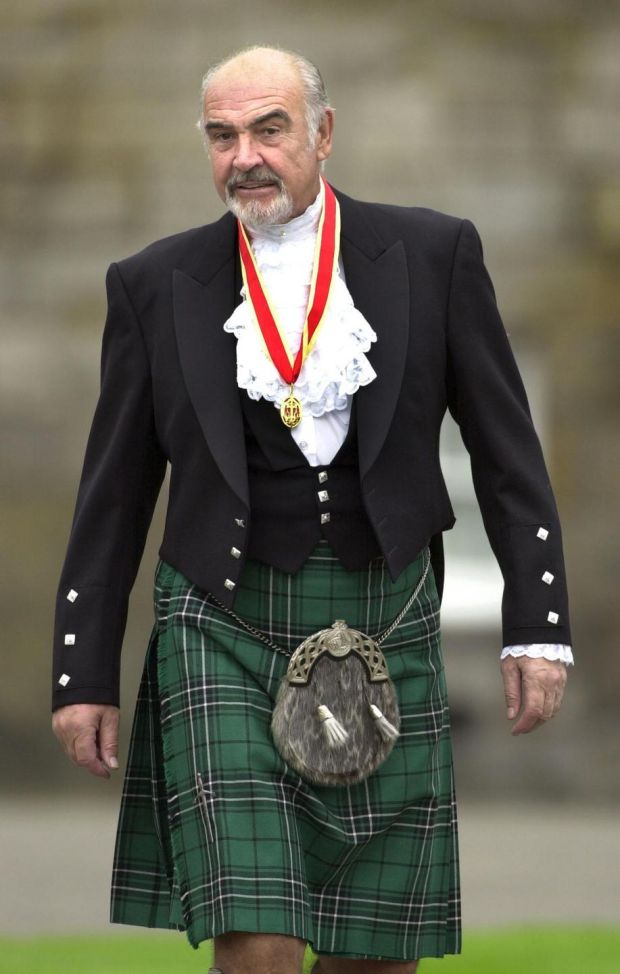 Sir Sean Connery, Wednesday July 5, 2000 in Highland dress and wearing his medal after he was formally knighted by Britain's Queen Elizabeth II during a ceremony in his home city Edinburgh, Scotland. The Scottish screen legend, who was honoured at the Palace of Holyroodhouse in Edinburgh, knelt while the Queen touched his shoulders lightly with a sword and made him a Knight during the ceremony in the Palace's Picture Gallery. (AP Photo/ David Cheskin/WPA pool)
