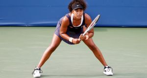 Naomi Osaka  waits for a serve  during a second round match at the Western and Southern Open at the USTA National Tennis Centre in Flushing Meadows, New York, US. Photograph: Jason Szenes/EPA