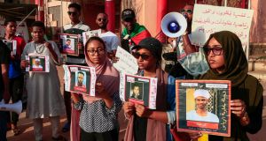 Sudanese protesters hold images of missing people during a rally in the capital, Khartoum, last year. Photograph: Ebrahim Hamid/AFP via Getty