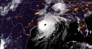 Satellite image showing Hurricane Laura reaching the coasts of Louisiana and Texas on Wednesday evening. Photograph: AFP/Getty Images.