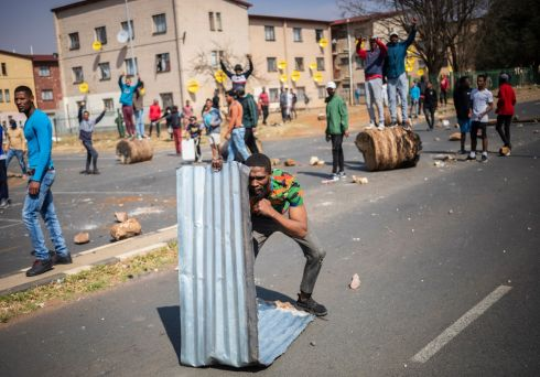 Protests break out in Eldorado Park, Johannesburg, South Africa, after police allegedly shot and killed an unarmed teenager. Photograph: Kim Ludbrook/EPA