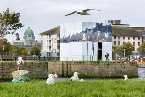 THE BIG REVEAL: The building of artist John Gerrard's Mirror Pavilion at Claddagh Quay in Galway city nearing its completion for its unveiling in September as part of Galway International Arts Festival Autumn Edition. Photograph: Joe O'Shaughnessy