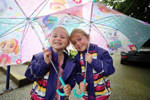 BRIGHT BEGINNINGS: Four-year-olds Lucy and Chloe Cummins, from Enfield, Co Meath during their first day in junior infants class at Primrose Hill National School in Celbridge, Co Kildare. Photograph: Paddy Cummins/IrishPhotodesk.ie