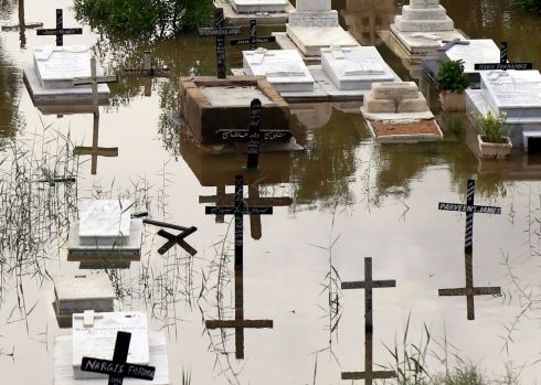 WASHOUT: An inundated Christian cemetery after heavy monsoon rains in Karachi, Pakistan. Sindh provincial government declared an emergency after floods in several areas of Karachi. Photograph: Rehan Khan/EPA