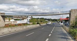 Gardaí in south Dublin received several complaints from members of the public about a group of people hanging large banners over the edge of the footbridge on the N11 at Kilmacanogue. Image: Google Maps