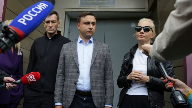 Alexei Navalny's brother Oleg (left), Navalny's colleague Ivan Zhdanov and Alexei Navalny's wife Yulia speak to the media at the hospital in Omsk, Russia. Photograph: Evgeniy Sofiychuk/AP Photo