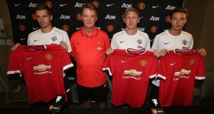 Louis van Gaal with new signings Morgan Schneiderlin, Bastian Schweinsteiger, and Matteo Darmian in July 2015. Photograph: John Peters/Getty
