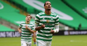Christopher Jullien celebrates after scoring Celtic's third against Motherwell. Photograph: Ian MacNicol/Getty