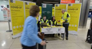 A public awareness campaign for Covid-19 at Dublin Airport. Photograph: Alan Betson