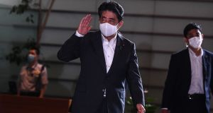 Japan's prime minister Shinzo Abe arrives at his office in Tokyo on Monday. Abe announced on Saturday that he will resign, ending his record-breaking tenure in a bombshell development that kicks off a leadership race in the world's third-largest economy. Photograph: Charly Triballeau/ AFP via Getty Images