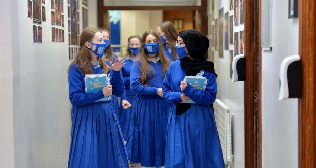Transition year students wearing face masks use a one-way system along the corridors on their first day back at school at Mount Sackville Secondary School in Chapelizod, Dublin. Photograph: Alan Betson
