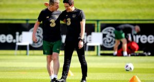 Republic of Ireland manager Stephen Kenny with assistant  Keith Andrews during a training session at  Abbotstown on Monday. Photograph: Ryan Byrne/Inpho