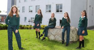 Fifth-year Salerno Secondary School students wearing the newer trouser and older skirt school uniforms. From left: Síofra McCormack, Leah Ruane, Sarah Casserly, Cliodhna McDonald and Ria Banerjee. Photograph: Joe O'Shaughnessy