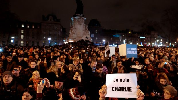 "On the evening of January 7th, 2015, people hold placards saying ""I am Charlie"" after the massacre perpetrated at the Charlie Hebdo offices that day, in a gathering at the Place de la Republique in Paris. File photograph Joel Saget/AFP/Getty"