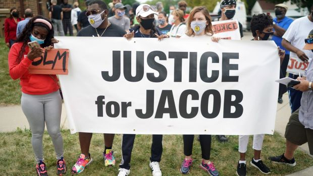 Protesters gather near the site where Jacob Blake was shot by police in Kenosha, Wisconsin. Photograph: Chang W Lee/The New York Times