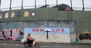 A mural on the Catholic side of the Cupar Way in Belfast. Photograph: Kaveh Kazemi/Getty Images