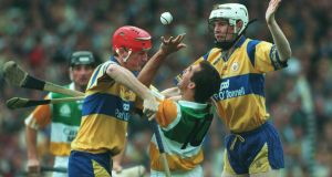 Brian and Frank Lohan of Clare  tackle Johnny Dooley of Offaly during the 1995 All-Ireland hurling final. Photograph:     Patrick Bolger/Inpho