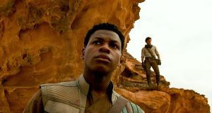 Actors John Boyega as Finn  and Oscar Isaac as Poe Dameron in Star Wars: The Rise of Skywalker.