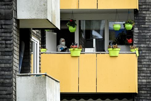 GERMAN DEATHS: Forensic investigators are seen at work in an apartment building in Solingen, Germany, where five children were found dead. Photograph: Sascha Steinbach/EPA