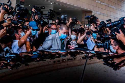 HONG KONG HEARING: Hong Kong pro-democracy media mogul Jimmy Lai (C) leaves court after he was found not guilty of criminal intimidation. Photograph: Isaac Lawrence/AFP via Getty Images