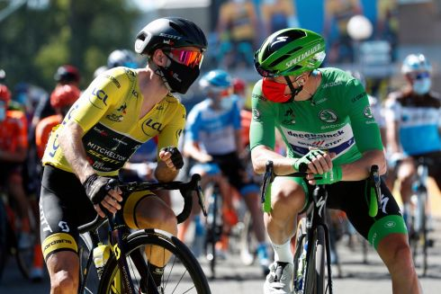 GREEN JERSEY: Britain's Adam Yates speaks with Ireland's Sam Bennett, wearing the best sprinter's green jersey, at the start of the Tour de France's sixth stage. Photograph: AP Photo/Thibault Camus