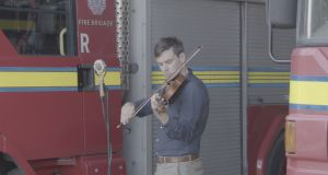 Fiddle player Liam O'Connor on site in the Fire Brigade Training Centre in the Coombe