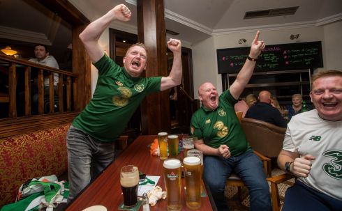 Ireland fans Andy Whelan, Patrick Hegarty and Alan Condron celebrate Shane Duffy scoring a goal at Taylors of Johnston, in Navan, Co Meath. Photograph: Ryan Byrne/Inpho