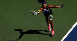 Naomi Osaka returns a shot during her match against Marta Kostyuk. Photograph: Al Bello/Getty Images
