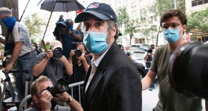 Michael Cohen returning to his apartment, in New York, after being released from prison in July. Photograph: AP